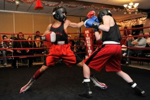 Cheng (right) vs. opponent in boxing bout on way to TKO