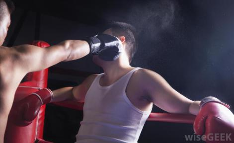 Illustration of guy wearing boxing glove punching another guy in gloves in the face