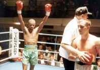 pkt2656-180337 DUKE MCKENZIE BOXER Duke McKenzie after win agent Peter Buckley Duke McKenzie on the attack against Peter Buckley and now he wants another crack at a world title A jelly tot by the name of Jessica has got Duke McKenzie wobbling towards a place in British boxing history. The 29 year old Londoner revealed that love for his one-year-old daughter, and the desire to provide for her future, are the driving forces behind his bid on Thurs 15 Oct to become the first British boxer this century to win world titles at three different weights. McKenzie cleared the way to challenge tough Texan Jess Benavides for the WBO super-bantam weight title at the Lewisham Theatre with a comfortable victory over Peter Buckley at Bethnal Green.
