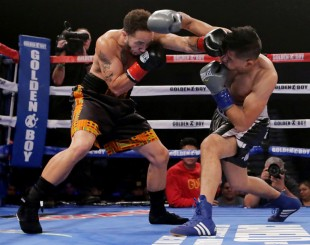 """Patricio """"Cacahuate"""" Manuel boxes Hugo Aguilar in the second round of their super featherweight four round bout during a Golden Boy Fight Night at Fantasy Spring Resort Casino in Indio on Saturday, December 8, 2018. (Photo by Terry Pierson, The Press-Enterprise/SCNG)"""